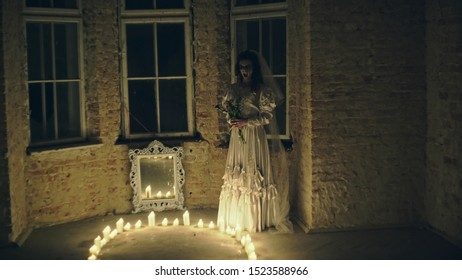 Scary dead bride with scars inside spooky house