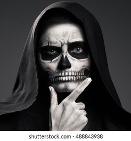 Scary Death Ponders Supporting His Head Arm. Realistic Skull Makeup.