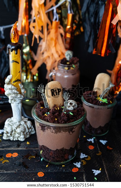 Scary dessert for Hallowen made from chocolate cake and chocolate mousse