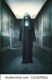 Scary devil nun standing on abandoned place. Halloween concept