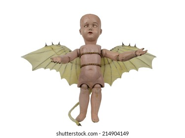 Scary doll with creepy eyes Da Vinci wings and devil tail standing isolated on white