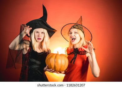 scary face and funny face halloween girls through hole in orange wall festive halloween