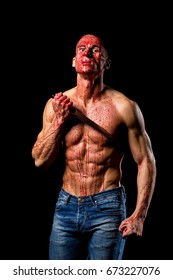 scary fitness muscular male model covered in blood with knife
