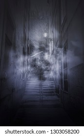 Scary foggy stairs from an european old alley at night