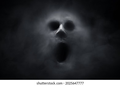Scary ghost on dark background