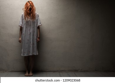 Scary ghost woman in nightgown with knife / halloween, zombie concept