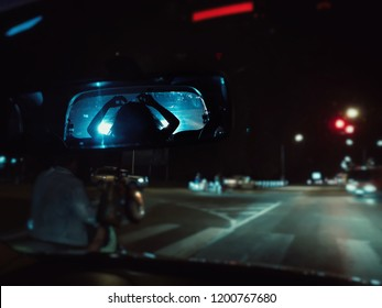 Scary ghost woman in rear view mirror of car, Halloween Horror scene background.