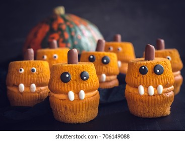 Scary halloween cup cakes served,selective focus
