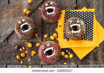 Scary Halloween donuts with chocolate frosting and sugar sprinkles