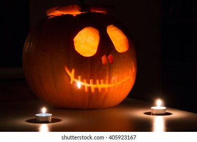 Scary Halloween pumpkin with candels. Scary glowing face trick or treat
