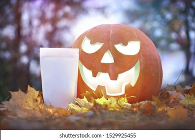 Scary halloween pumpkin with a candle inside in the evening in yellow lithium. gloom celebration product packaging template