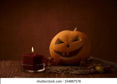 Scary halloween pumpkin jack-o-lantern on dark background