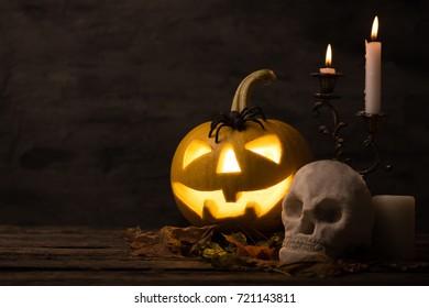Scary halloween pumpkin with skull in a spooky night. Halloween scene.