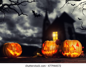 Scary halloween pumpkins with horror background. Empty space for text