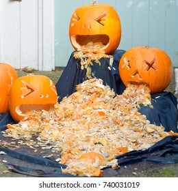 Scary Halloween pumpkins throwing up their insides