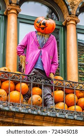 Scary Halloween statue with pumpkins