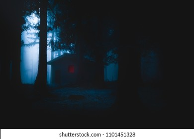 scary house illuminated in mysterious horror forest at the night