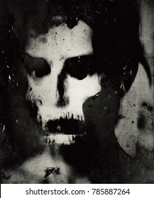 Scary human skull isolated on grunge background. Spooky horror wallpaper.