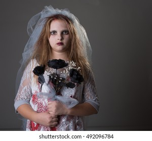 Scary kid as a zombie bride for trick or treat