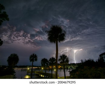 Scary lightning over Florida marina lights up the ominous clouds and Anclote River, Tarpon Springs, Florida