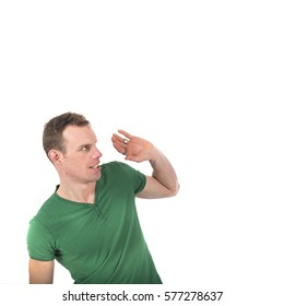 Scary man in green shirt isolated over white background