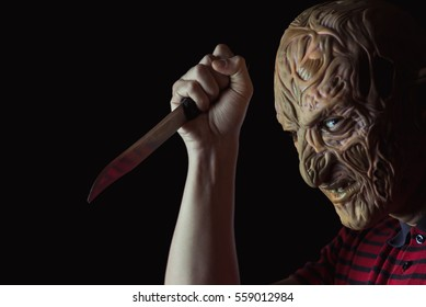 Scary mask. A man with a kitchen knife