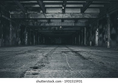 scary night underground parking. old abandoned building.