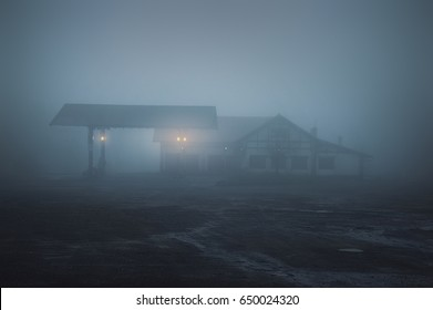 scary old gas station at the night