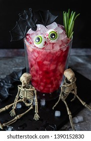 Scary pink  cocktail with candy eyes for Halloween