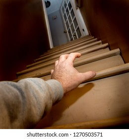 A scary point of view from an elderly person who has fallen down the stairs illustrating the need for safety measures