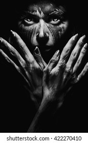 Scary portrait of the woman. Demon theme on Halloween. Black-and-white Version of the Image