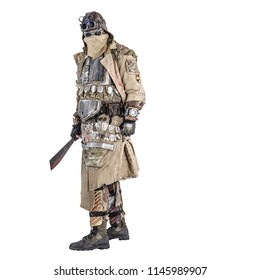Scary post apocalyptic survivor in handmade armored clothes, armed with machete, dangerous creature with face hidden behind mask and glasses, in rags, standing with cold weapon in hand studio shoot