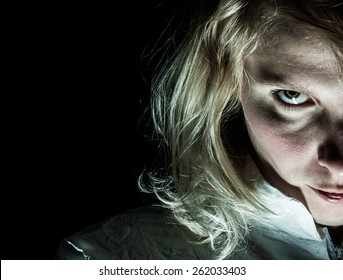 Scary Psycho Blonde Woman Looking at the Camera