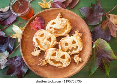 Scary puff pastry pumkpin pies for a Happy Halloween