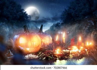 Scary pumpkin in a dark smoky garden on Halloween night
