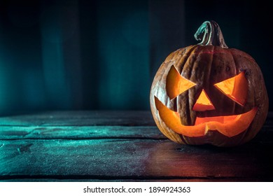 A scary pumpkin lantern with evil grin for Halloween.