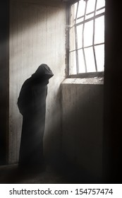 Scary Reaper waiting in a dark abandoned building