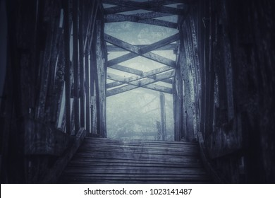 scary scene with old wooden bridge and forest background, photo have some noise and vignette.