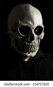 Scary skeleton on black background.
