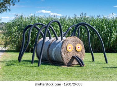 scary spider made of round hay bales and plastic pipe