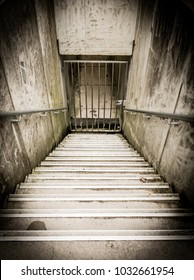 Scary, spooky stairs in prison sepia
