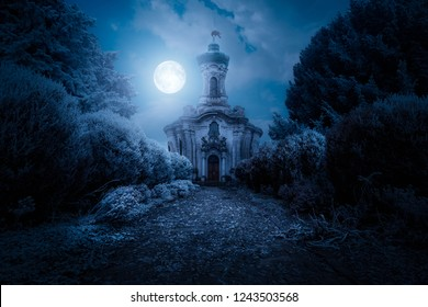 Scary view of church and spooky cloudy sky with moon, Horror Halloween concept