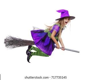 Scary witch girl flying on a broom isolated on white