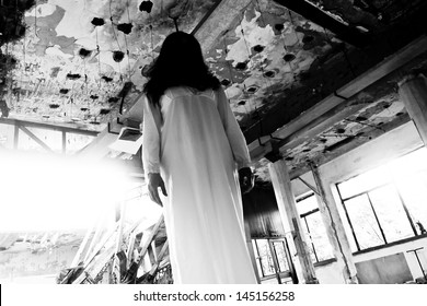 Scary woman in the abandoned hotel