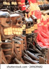 Scary wooden souvenirs in Chichen Itza, Mexico