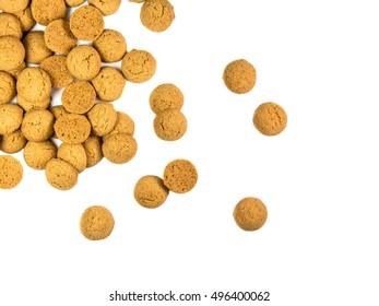Scattered bunch of Pepernoten cookies as Sinterklaas decoration on white background for dutch sinterklaasfeest holiday event on december 5th