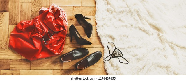 scattered clothes and lovers shoes. Night of love. Selective focus. sex.