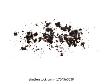 Scattered crumbs of chocolate sandwich cookies filled with sweet cream flavored isolated on white background.