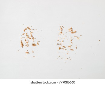 Scattered crumbs isolated on white background
