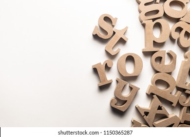 Scattered English letters with STORY word on white background